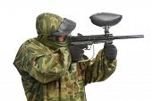 paintball player man in protective camouflage uniform with mask Aiming marker gun over white backgro