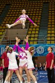 MOSCOW - MAR 24:  Girls cheerleaders team performs acrobatics at Championship and Contests of Moscow