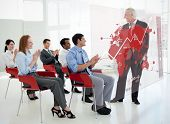 Business people clapping stakeholder standing in front of red map diagram interface in a meeting