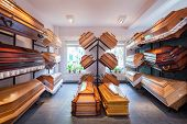 stock photo of coffin  - Funeral home with plenty of different coffins - JPG