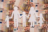 Paper family on euro money