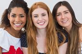 Close up portrait of cheerful young female friends at home