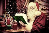 picture of nicholas  - Santa Claus making Christmas gifts at home - JPG