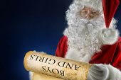 pic of nicholas  - Santa Claus reading a list of good boys and girls - JPG