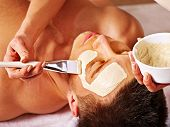 image of beauty parlour  - Man with clay facial mask in beauty spa - JPG