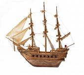 Antique ship as wooden model on white background.