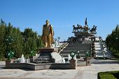 Monumen Of Niyazov And Sculptural Composition To Fast Horses In The Park. Ashkhabad. Turkmenistan.