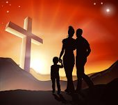 picture of holy family  - A Christian family walking towards a cross in a mountain landscape with sunrise over mountains Christian lifestyle concept - JPG