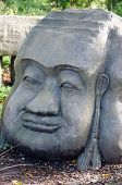 Stone head carving of an idol