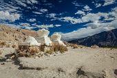 Whitewashed chortens (Tibetan Buddhism stupa) in Himalayas. Nubra valley, Ladakh, India