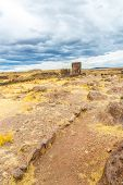 stock photo of urn funeral  - Funerary towers in Sillustani PeruSouth America - JPG