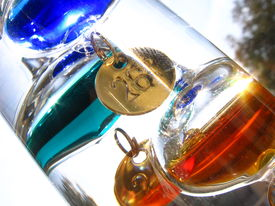 stock photo of galileo-thermometer  - A detail on a Galileo Thermometer mesuring 27 - JPG