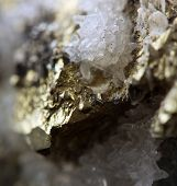 picture of iron pyrite  - Crystalnugget gold bronze copper iron. Macro. Extreme closeup