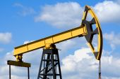 image of nonrenewable  - Oilfield Pump Jack with a bright blue sky and clouds - JPG
