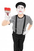 Mime artist holding a paintbrush isolated on white background