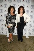 LOS ANGELES - APR 22:  Joan Collins, Jackie Collins at the Women's Guild Cedars-Sinai Luncheon at Be
