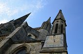 stock photo of sundial  - Chichester Cathedral with its ornate medieval sundial on its exterior wall - JPG