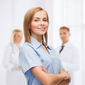 healthcare and medicine concept - smiling female doctor or nurse