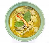 Thai cuisine green curry chicken on white background