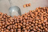 Pile Of Roasted Chestnut With Spoon For Retail Sale In Market