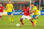 VIENNA,  AUSTRIA - JUNE  7 Alexander Kacaniklic (#19 Sweden) and David Alaba (#8 Austria) fight for