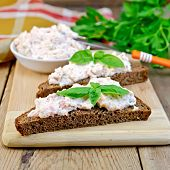 Sandwich With Cream Of Salmon And Knife On Board
