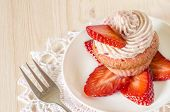 Strawberry Cupcake With Butter Cream Decorated With Slices Of Fresh Strawberries