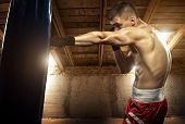 stock photo of bandage  - Young man boxing exercise in the attic - JPG