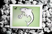 Loan shark doodle on digital tablet on crumpled paper
