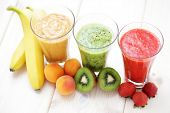 various fruity shakes with fresh fruits - food and drink