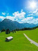 hut and alpine landscape