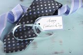 Happy Fathers Day Blue Tie With Gift Tag On Vintage Aqua Blue Rustic Shabby Chic Table With Greeting