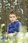 Sad Boy In The Woods.