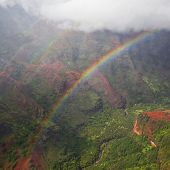 Magical rainbow in Waimea Canyon in Kauai from a helicopter