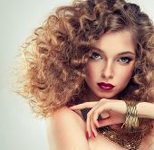 image of jewelry  - Model curly hair and the red manicure - JPG