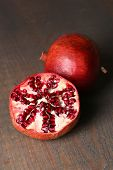 Ripe pomegranates on wooden background