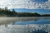 Cloudy Sky Reflecting On An Autumn Lake