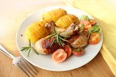 roasted chicken leg with fried potato