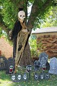 Death in a black hood and other scary Halloween decorations.