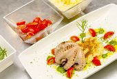 Octopus With Mashed Potatoes Inside A Plate With Delicious Composition With Cherry Tomatoes And Pest