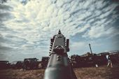 stock photo of mg  - Old vintage machine gun standing on tripod - JPG