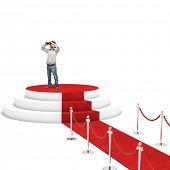 man with binoculars and red carpet