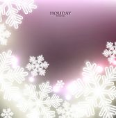 White defocused snowflakes on glow background. Christmas abstract background. Vector illustration
