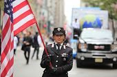 Woman in uniform with US flag