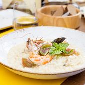 Seafood Risotto With Shrimp, Tomatoes And Basil