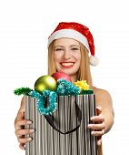 Young Woman In Santa Hat With Christmas Attributes And Gifts