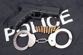 Police Concept With Gun Ammo And Handcuffs