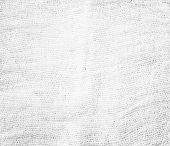 Perspective and closeup view to abstract canvas of empty light gray and white natural clean gauze texture for the traditional business background with sparse threads and clear space for your own text.