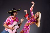 Spanish pair playing guitar and dancing
