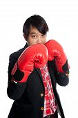 Asian Man Wear Boxing Gloves Keep His Guard Up